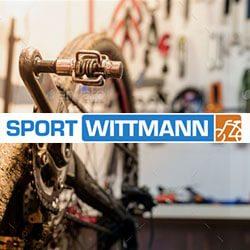 Fahrradwerkstatt im Vordergrund das Logo von Sport Wittmann Freising