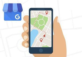 Google myBusines Logo und Smartphone mit Maps und Route eingezeichnet, illustriert